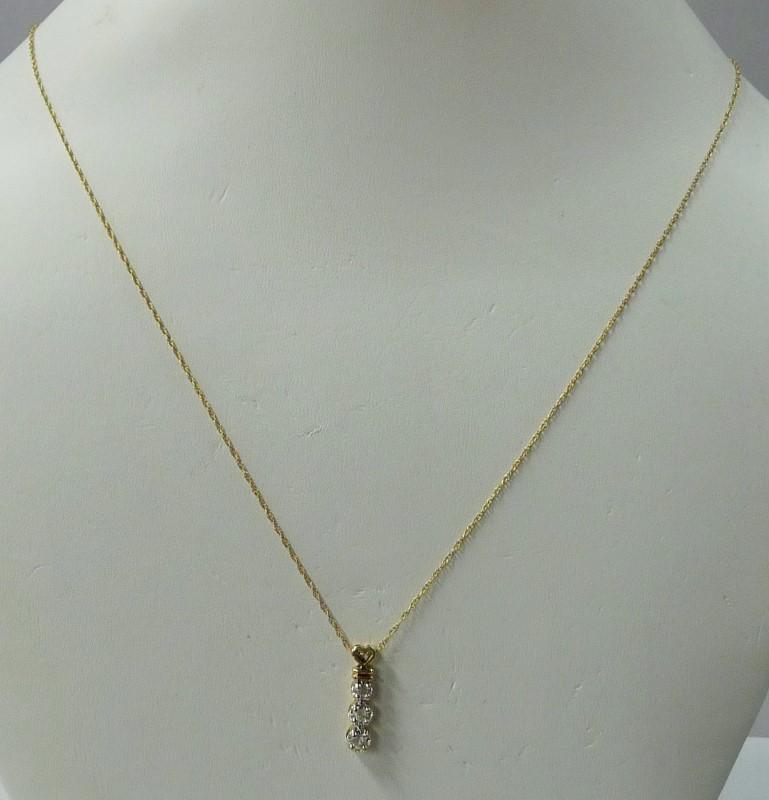 Diamond Necklace 3 Diamonds .18 Carat T.W. 14K Yellow Gold 1.56dwt