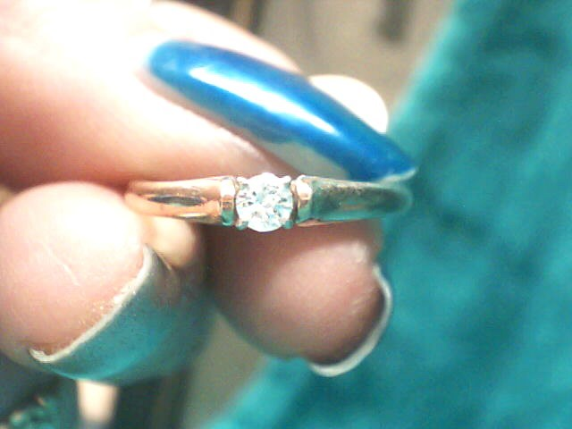 Lady's Diamond Solitaire Ring .08 CT. 10K Yellow Gold 1.2dwt