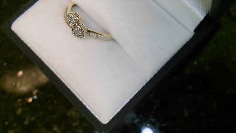 Lady's 10k yellow gold 2-1mm round diamond double heart ring