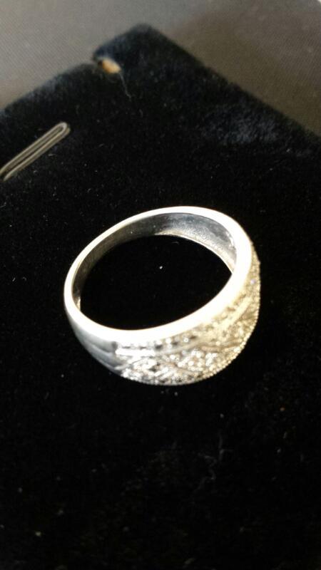 Lady's Diamond Cluster Ring 13 Diamonds .065 Carat T.W. 10K White Gold 1.99dwt
