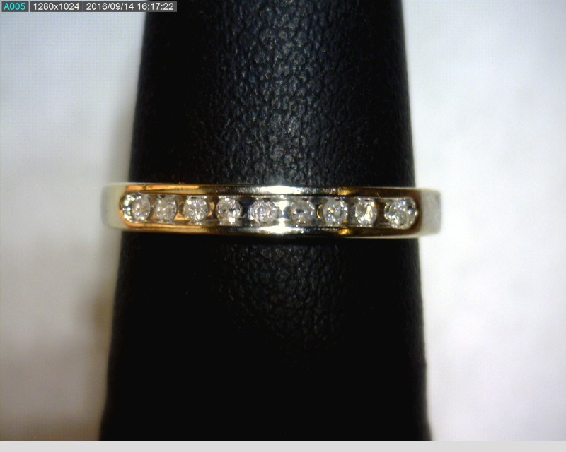 Lady's Diamond Fashion Ring 9 Diamonds .09 Carat T.W. 10K White Gold 0.95dwt