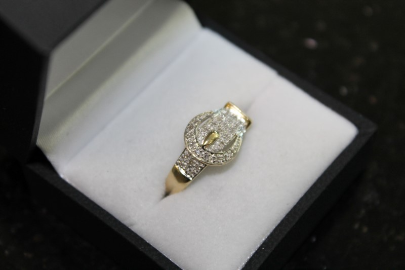 lady's 14k yellow gold round diamond buckle ring