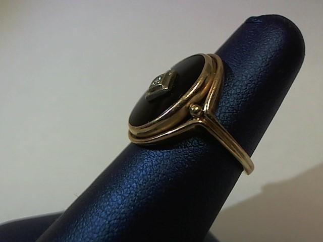 Black Stone Lady's Stone & Diamond Ring .02 CT. 14K Yellow Gold 4.7g Size:6