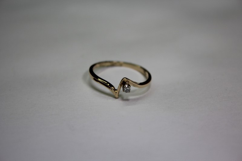 Lady's Diamond Solitaire Ring .03 CT. 14K Yellow Gold 1.2g Size:6.3
