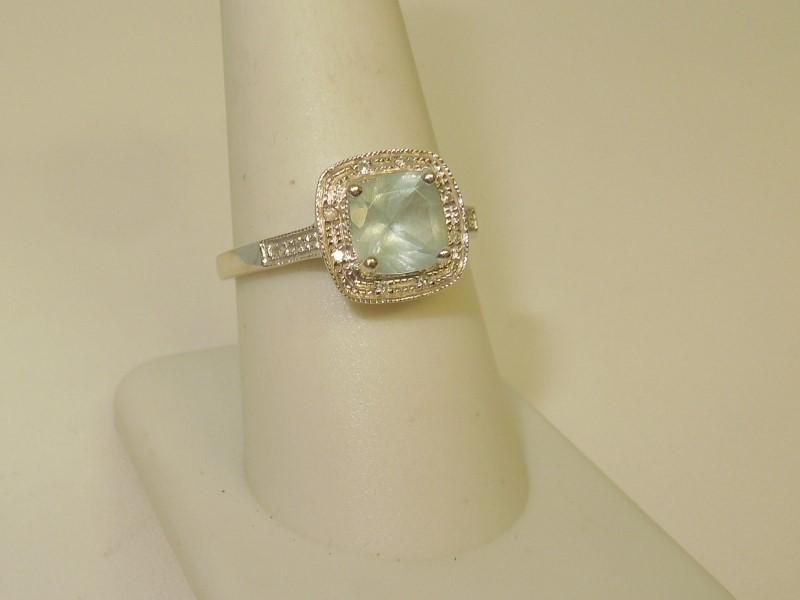 Synthetic Aquamarine Lady's Stone & Diamond Ring 12 Diamonds .060 Carat T.W.