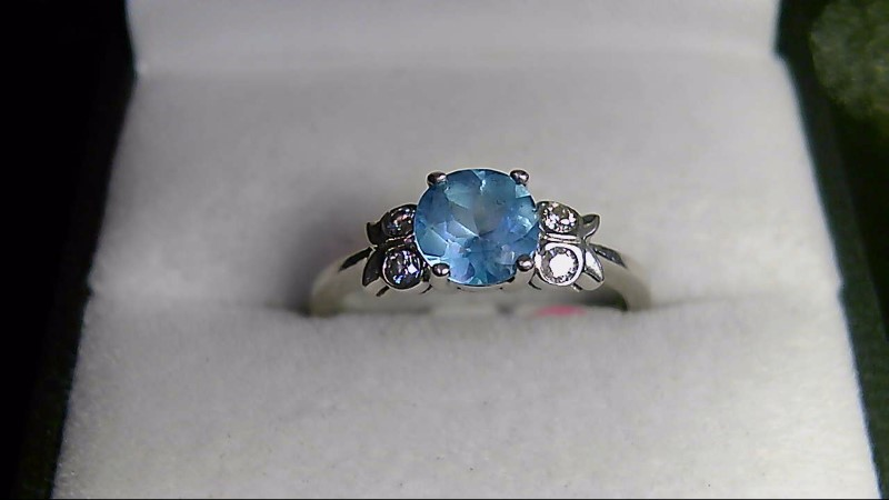 lady's 14k white gold round sky blue topaz diamond ring