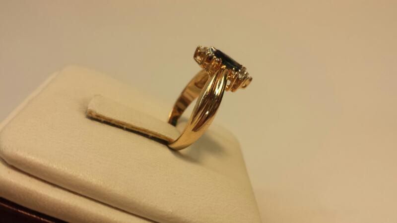 14k Yellow Gold Ring with 1 Marquise Blue Stone and 12 Diamonds - 1.9dwt