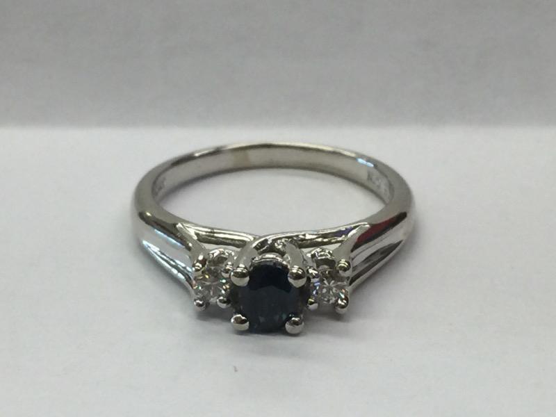 Blue Stone Lady's Stone & Diamond Ring 2 Diamonds .10 Carat T.W. 10K White Gold