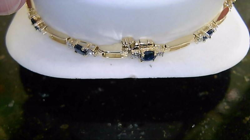 Lady's 14k yellow gold oval blue sapphire and round diamond bracelet