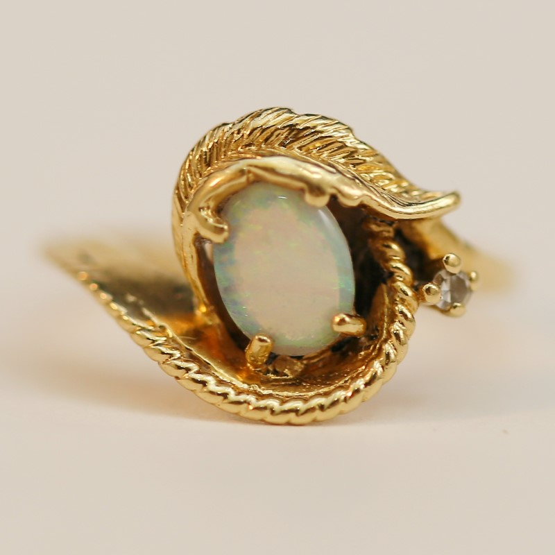 Unique Oval Cut Opal Wrapped in 14K Gold Feathers Ring Size 4.3