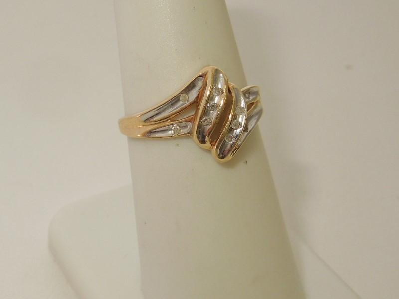 Lady's Diamond Fashion Ring 10 Diamonds .050 Carat T.W. 10K Yellow Gold 1.7g