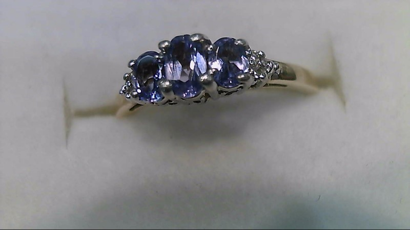Tanzanite Lady's Stone & Diamond Ring 4 Diamonds .04 Carat T.W. 10K Yellow Gold