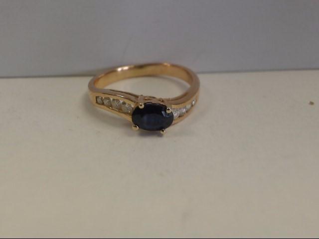 Sapphire Lady's Stone & Diamond Ring 8 Diamonds .24 Carat T.W. 14K Yellow Gold