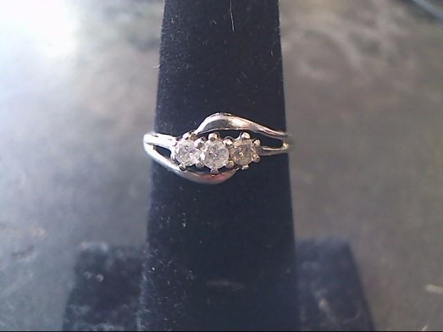 Lady's Diamond Wedding Band 3 Diamonds .30 Carat T.W. 10K White Gold 1dwt