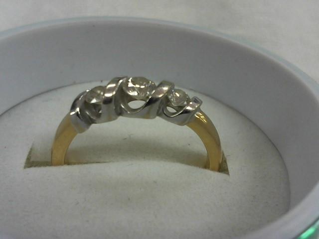Lady's Diamond Wedding Band 3 Diamonds .31 Carat T.W. 14K Yellow Gold 3.5g