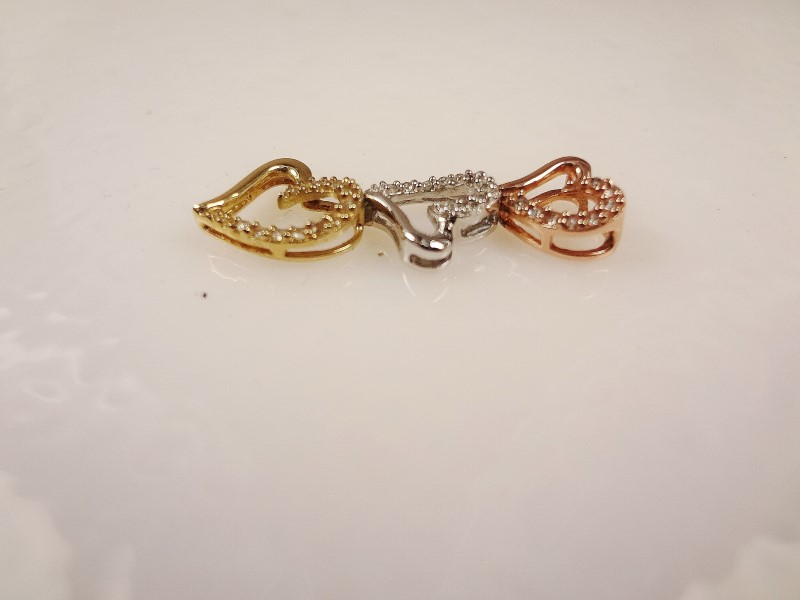 10k and Sterling Silver tri-color 3 diamond floating heart pendant