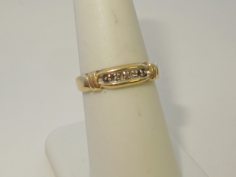 Lady's Diamond Fashion Ring 5 Diamonds .025 Carat T.W. 10K Yellow Gold 1.6g