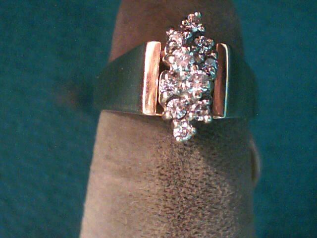 Lady's Diamond Cluster Ring 11 Diamonds .17 Carat T.W. 14K Yellow Gold 2.4dwt