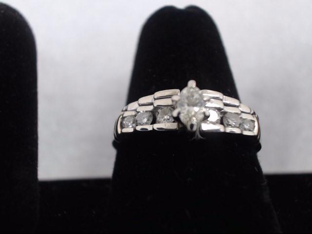 Lady's Diamond Solitaire Ring 7 Diamonds .56 Carat T.W. 10K 2 Tone Gold 3.9g