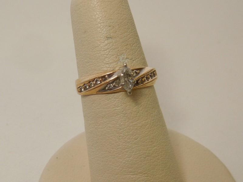 Lady's Diamond Fashion Ring 11 Diamonds .20 Carat T.W. 14K Yellow Gold 2.6g