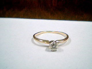 Lady's Diamond Solitaire Ring .03 CT. 10K 2 Tone Gold 1.4g Size:7.3