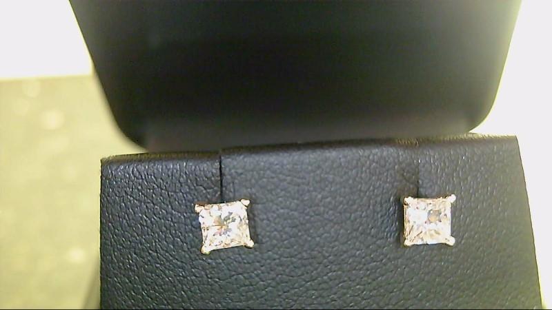 lady's 14k yellow gold apx. (.66ctw) princess cut diamond stud earrings