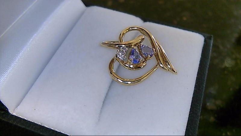 Lady's 10k yellow gold tanzanite and diamond heart pendant
