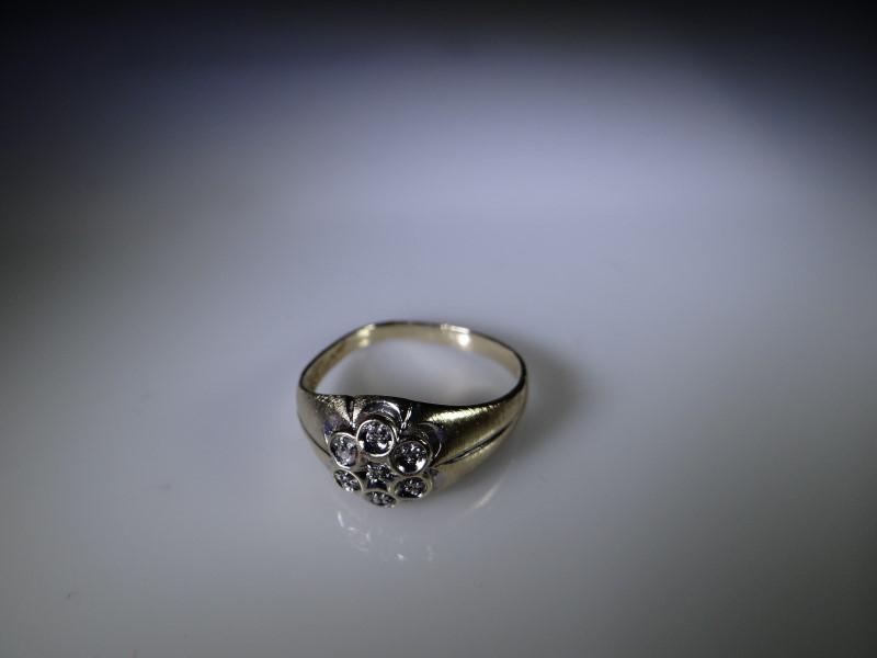 Lady's Diamond Fashion Ring 7 Diamonds .014 Carat T.W. 10K Yellow Gold 2.49g