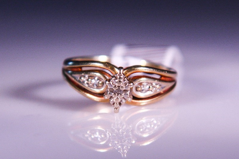 Lady's Diamond Solitaire Ring .05 CT. 10K Yellow Gold 3g Size:6.5