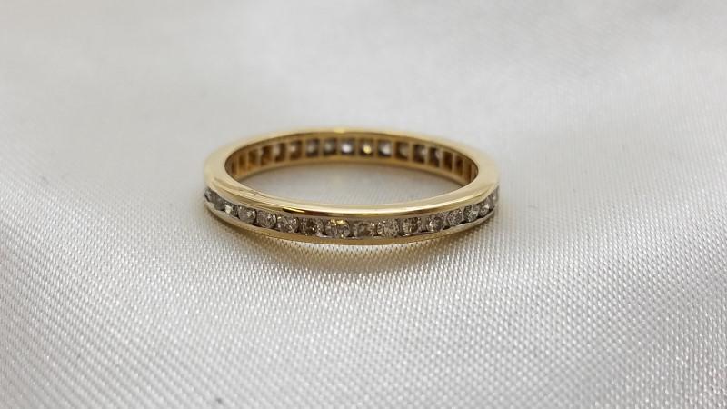 Lady's Diamond Wedding Band 13 Diamonds .26 Carat T.W. 14K Yellow Gold 1.6g