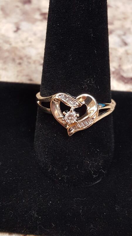 Lady's Diamond Fashion Ring 11 Diamonds .17 Carat T.W. 10K Yellow Gold 1.8dwt