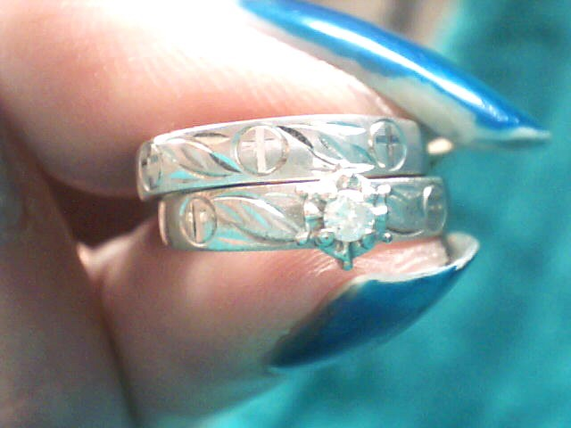 Lady's Diamond Wedding Set .05 CT. 10K White Gold 2dwt