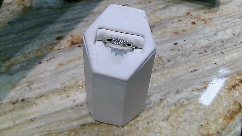 Lady's Diamond Fashion Ring 3 Diamonds .58 Carat T.W. 14K White Gold 3.6g