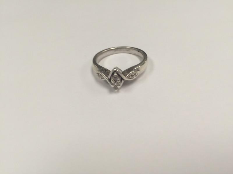 Lady's Silver-Diamond Ring 8 Diamonds .16 Carat T.W. 925 Silver 3.9g
