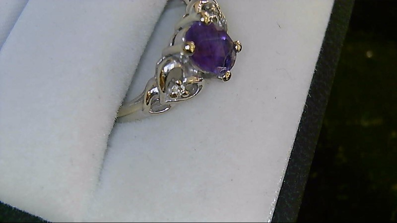 Lady's 14k white gold oval amethyst -2-1mm round diamonds sz 6.5 ring