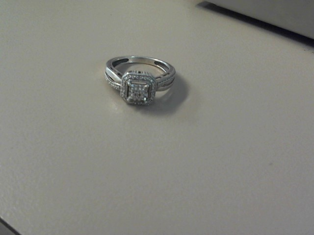 Lady's Silver-Diamond Ring 14 Diamonds .14 Carat T.W. 925 Silver 1.6dwt
