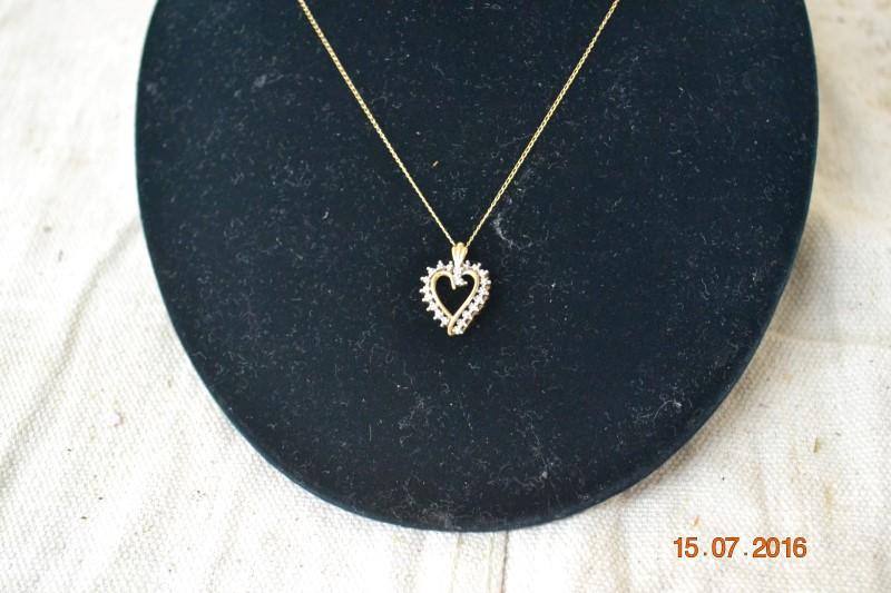 Diamond Necklace .01 CT. 10K Yellow Gold 1.9g
