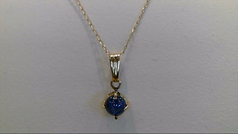 Lady's 14k yellow gold star sapphire 18 inch necklace