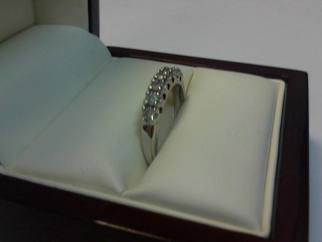 Lady's Diamond Wedding Band 7 Diamonds .21 Carat T.W. 10K White Gold 1.5dwt