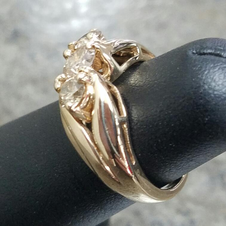 Lady's Diamond Fashion Ring 3 Diamonds .72 Carat T.W. 14K Yellow Gold 3.15dwt