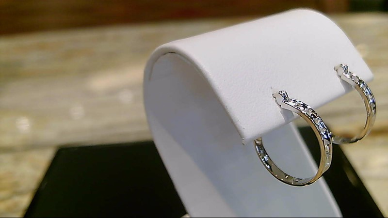 Lady's 10k white gold appx. .10cttw round diamond hoop earrings