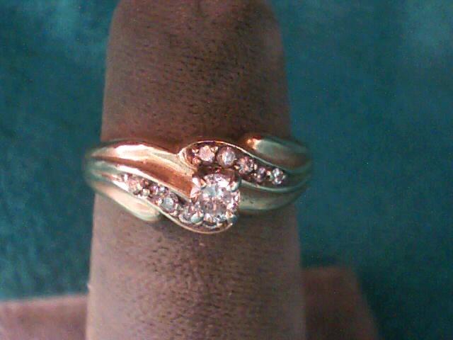 Lady's Diamond Solitaire Ring 11 Diamonds .18 Carat T.W. 14K Yellow Gold 2.3dwt