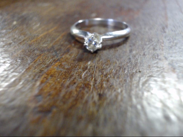 Lady's Diamond Solitaire Ring .10 CT. 14K White Gold 2.2g Size:6