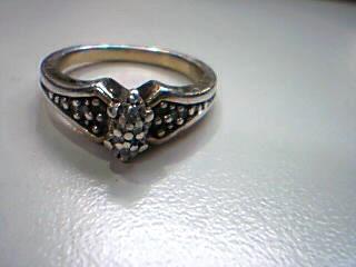 Lady's Silver-Diamond Ring 6 Diamonds .06 Carat T.W. 925 Silver 4.1g Size:7