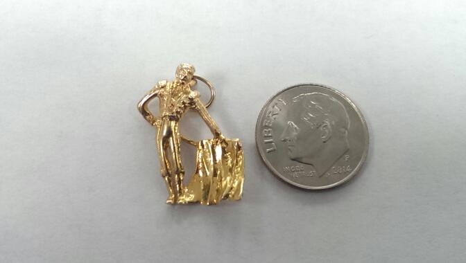 MATADOR 14K YELLOW GOLD CHARM, 2.8 GRAMS