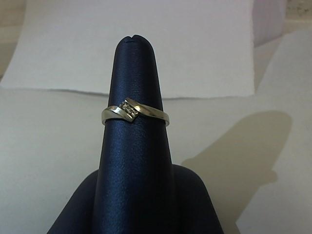 Lady's Diamond Fashion Ring 3 Diamonds .03 Carat T.W. 10K White Gold 1.7g