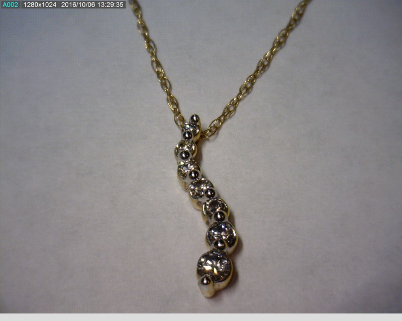 "18"" Diamond Necklace 7 Diamonds .17 Carat T.W. 10K Yellow Gold 1dwt"