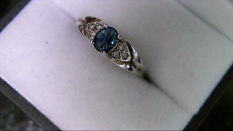 ESTATE WG 5X3 OVAL BLUE SAPP WITH 6-1MM RD DIAMOND ACCENT LADIES RING