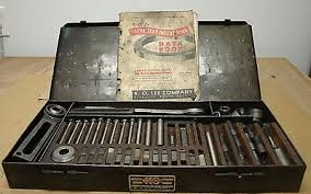 K. O . LEE COMPANY ABERDEEN, S.D. VINTAGE KNOCK OUT TOOL SET MODEL NO. R204