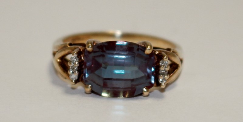 Synthetic Alexandrite Lady's Stone & Diamond Ring 4 Diamonds .08 Carat T.W.